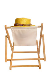 summer straw hat hanging on a deck chair