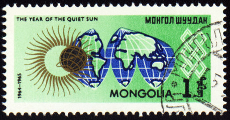 Post stamp with map Globe and symbol of the Sun