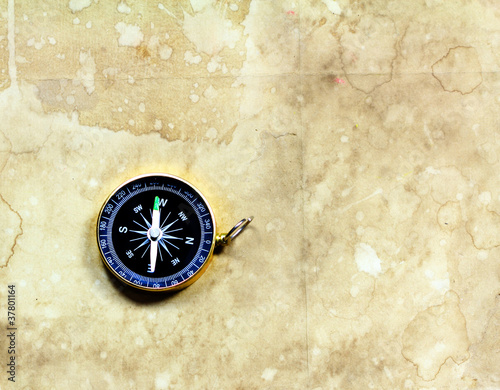 Compass with old gunge paper background
