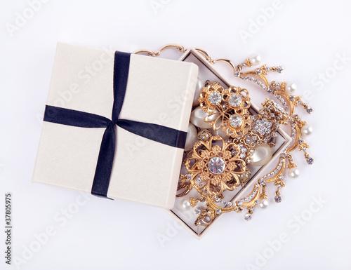 Golden jewelry in open box