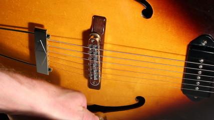 Jazz electric guitar sound check.
