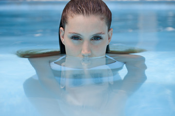 Beautiful woman in the swimming pool