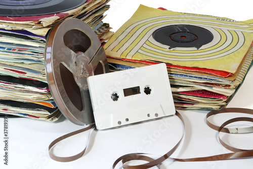 Vintage Records with Tape Reel and Cassette.
