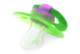 Green baby silicone pacifier on a white background