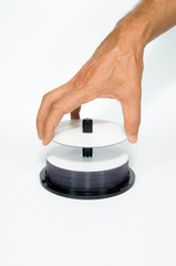 Hand Taking Blank Disk from Stack