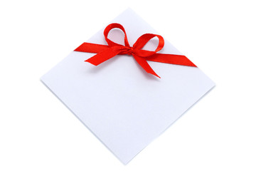 Piece of paper with red bow on a white background
