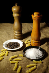 Salt and Pepper Grinders With Some Fusilli Pasta