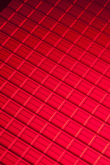 closeup on metallic sheet with red light