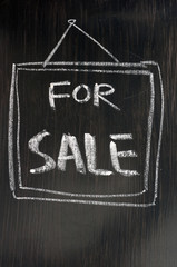 For sale - text written on blackboard