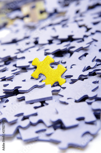Blue puzzle with one yellow element
