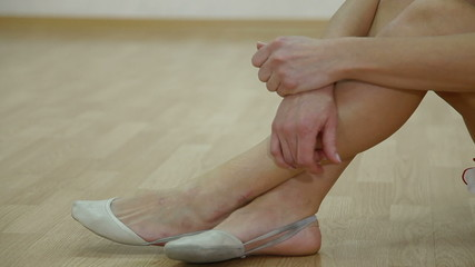 female feet in ballet slippers
