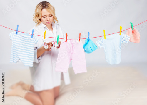 Woman with baby laundry