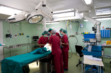 Anesthetic team preparing patient