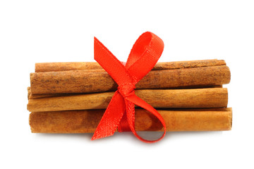Bunch of cinnamon sticks with red bow