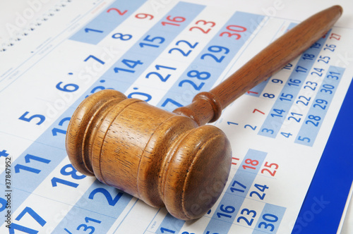 Wooden gavel on paper calendar