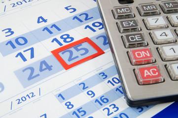 Calculator on calendar background