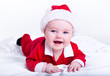 Adorable little santa baby smiling