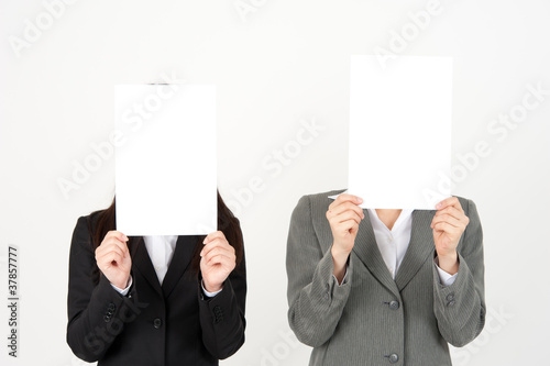 business team holding a blank whiteboard
