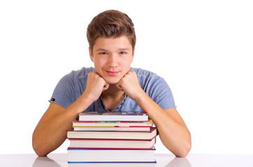 Schüler hinter Bücherstapel