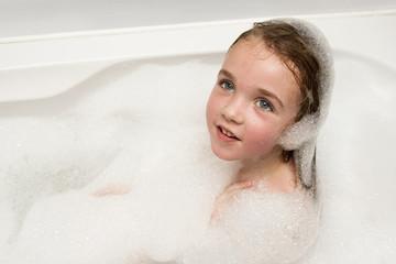Little girl in soap foam
