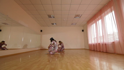Dancers in stage costumes practiced in dance studio