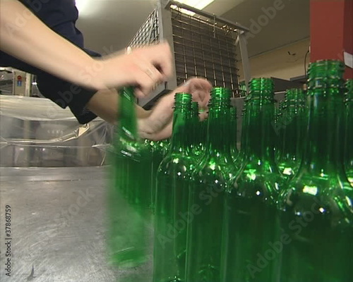 Worker packingt PET bottles. Plastics recycling.