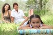 girl relaxing in park with mother and grandma