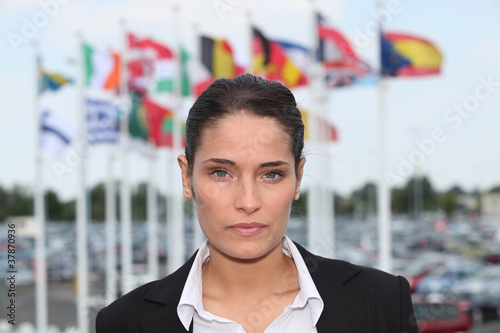 Brunette stood in front of flags