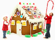 Boy and Girl Children Building Giant Gingerbread House