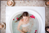 Enjoying a bath with rose petals in a spa
