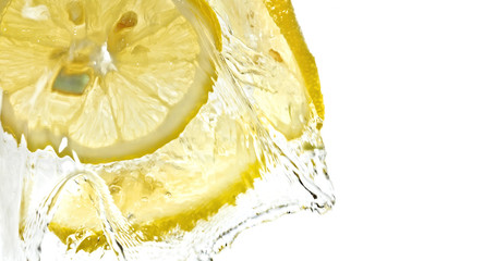 Transparent lemon slices in water splash