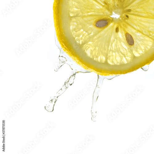 Lemon slice in water splash, isolated