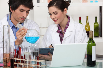 oenologists working in a lab