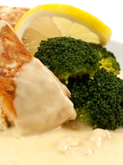 Salmon with broccoli and creamed lemon shrimp sauce