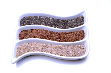 Chia and flax seeds on white background