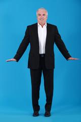 Businessman standing on tiptoes