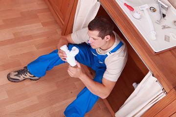plumber sitting