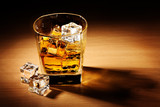 Fototapety glass of scotch whiskey and ice on wooden table