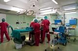 Anesthetic team preparing little patient fr poster