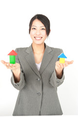 asian businesswoman taking small house