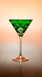 Green cocktail on a pink background