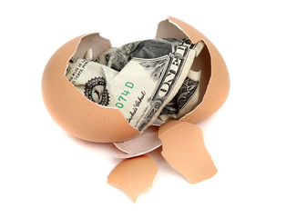 eggshell with one dollar bank note