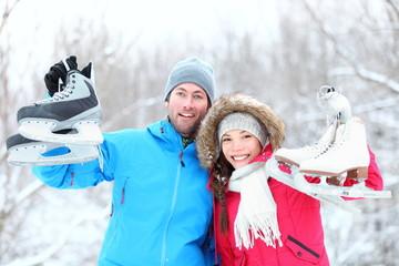 Happy ice skating winter couple