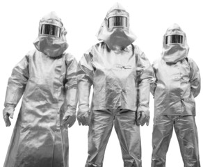 Three workers in protective clothing designed to withstand extre