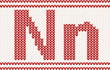 Red knitted Letter n on beige Background