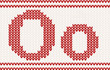 Red knitted Letter o on beige Background