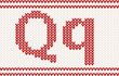 Red knitted Letter q on beige Background