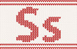 Red knitted Letter s on beige Background