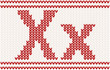 Red knitted Letter X on beige Background