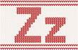 Red knitted Letter Z on beige Background